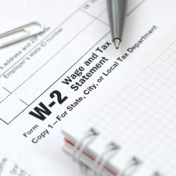 Close up of a W-2 form with a pen resting on the form.
